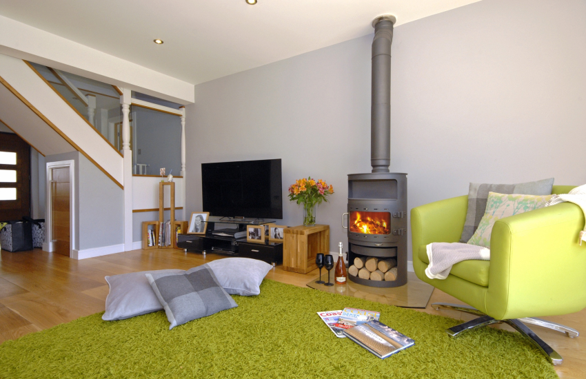 Open plan living area with wood burning stove