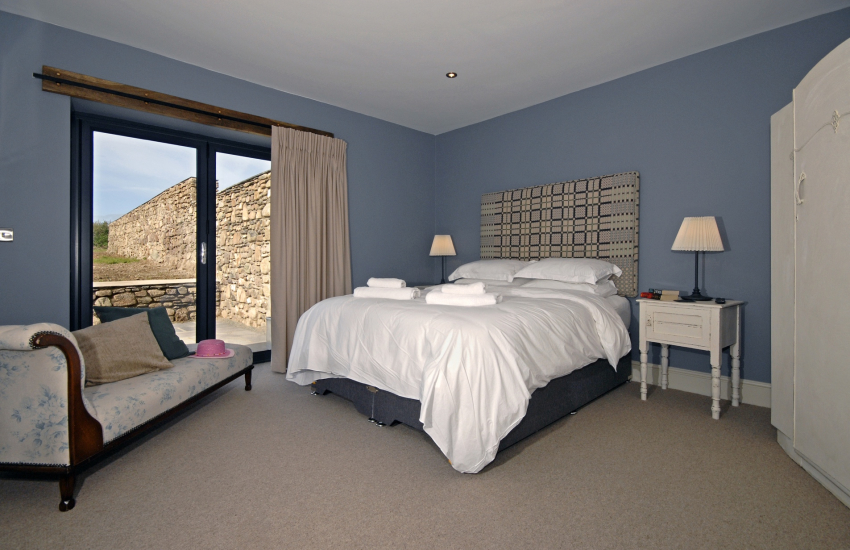Master king size bedroom with patio doors to the garden