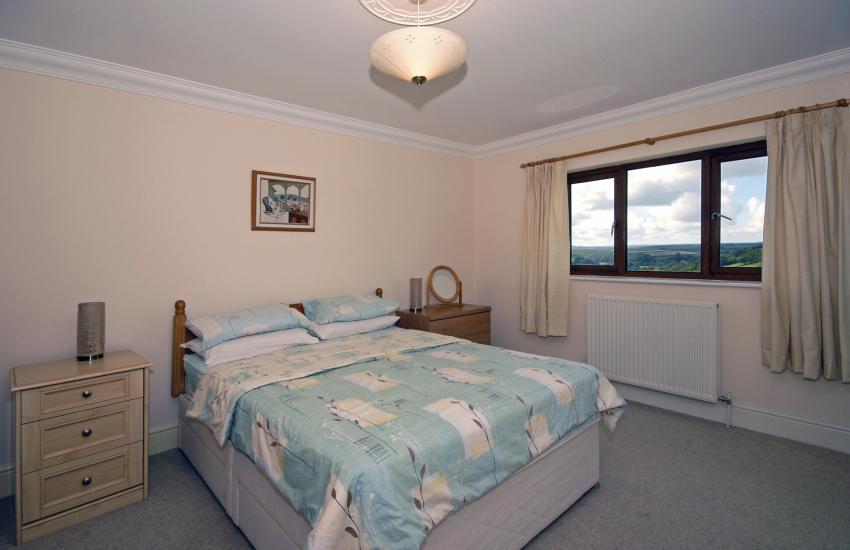 Double en suite bedroom with valley views