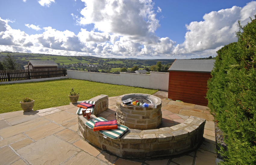 Teifi Valley holiday home - gardens with large stone fire pit