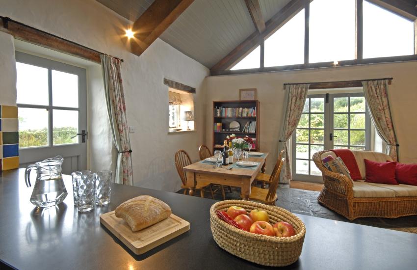 Modern open plan kitchen with Corian worktops