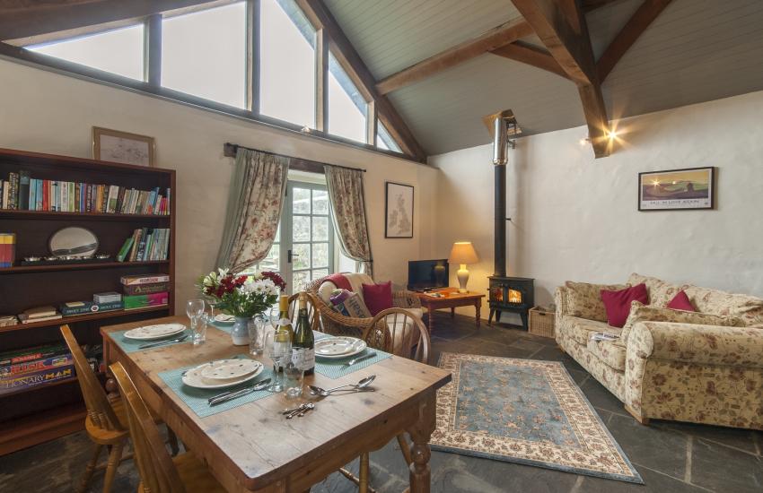 Lawrenny holiday cottage - living/dining room with log burner
