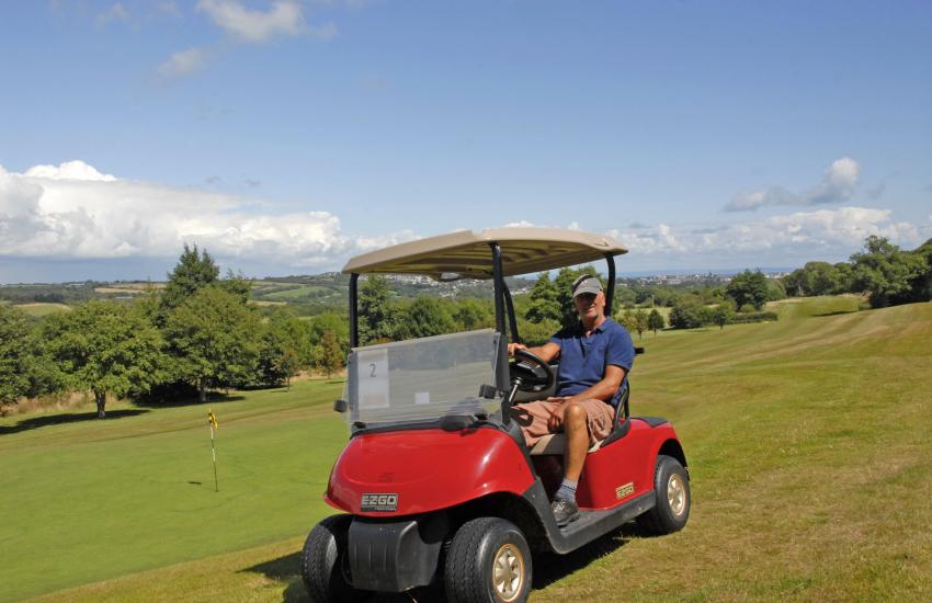 Tenby or Trefloyne Golf Clubs