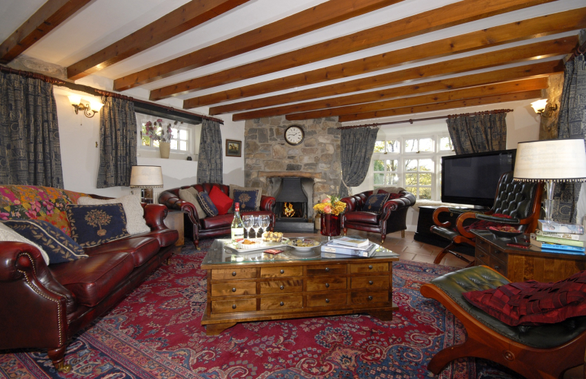St Davids traditional dog friendly holiday cottage cosy sitting room with open fire