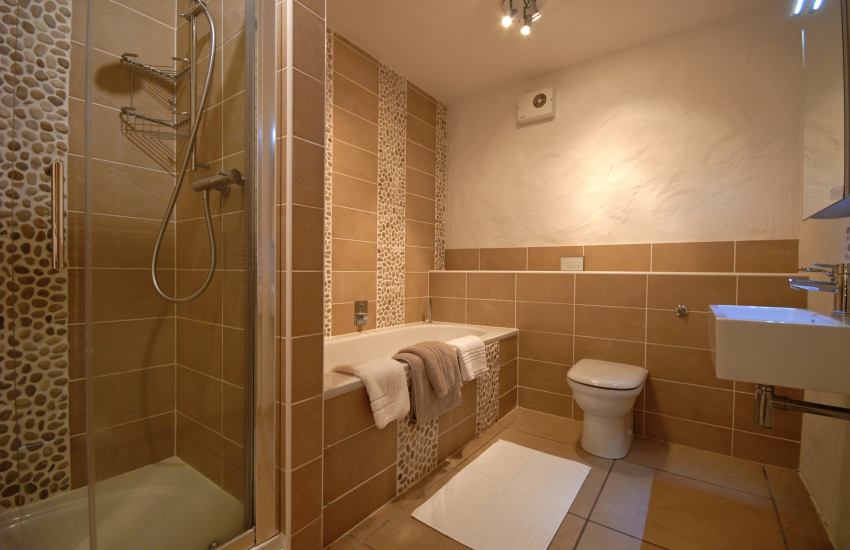 Lower ground floor family bathroom with separate shower