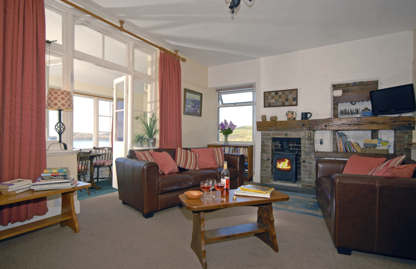 St Davids coastal holiday home - cosy lounge with sea views and log burning stove