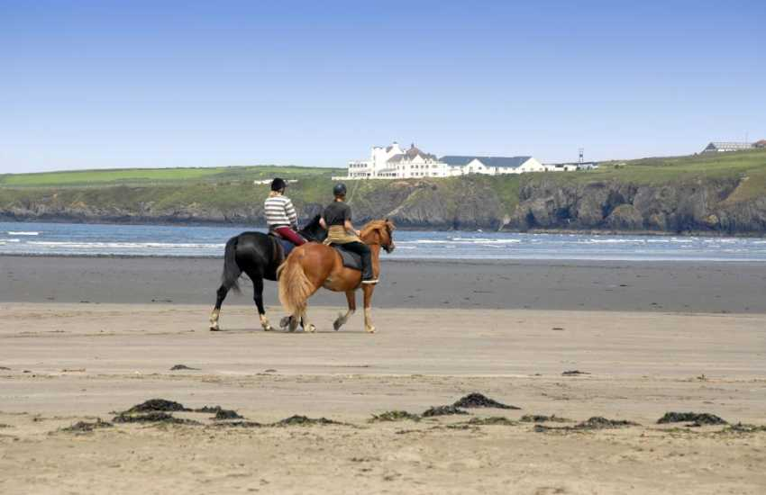 Horse riding along the sands of Poppit Beach, North Pembrokeshire.