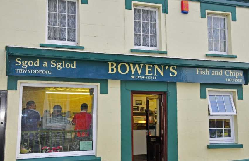 Delicious fish and chips with a glass of wine at Bowen's on the High St, St Dogmaels