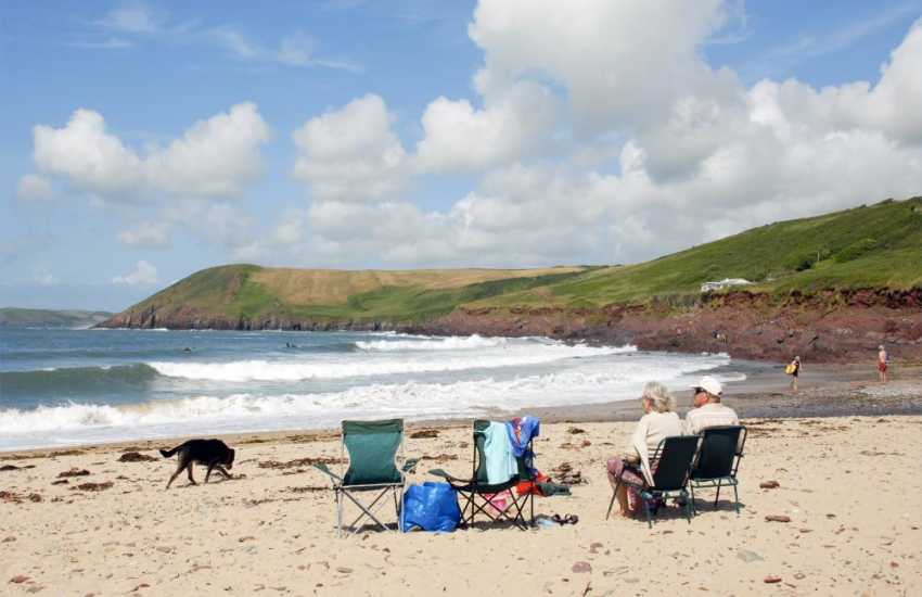 Manorbier Beach is a great favourite with golden sands to play on, rock pools to fish in and wonderful waves for swimmers and surfers alike