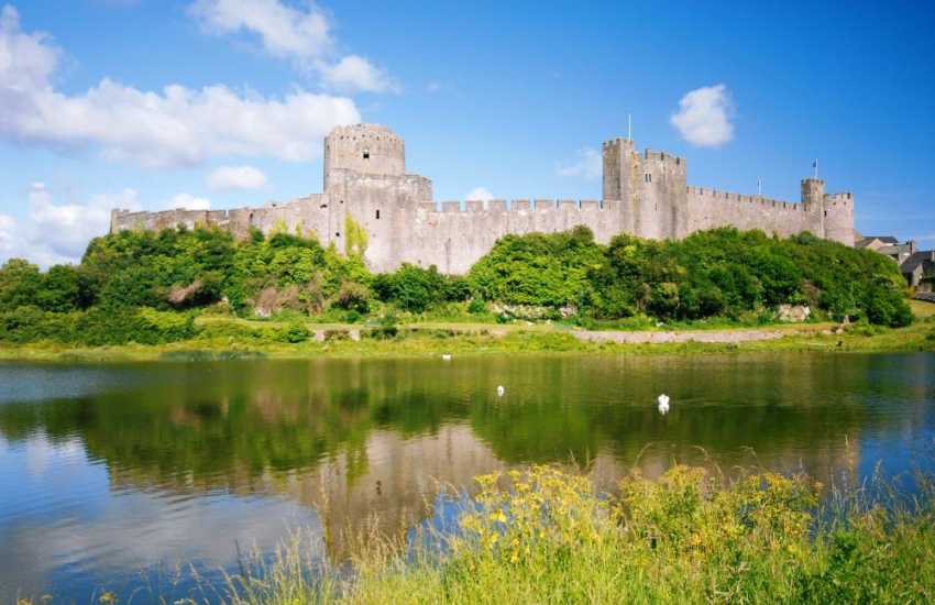 Magnificent medieval Pembroke Castle was birthplace of Henry VII. Enjoy falconry displays, music festivals and historical events in the grounds throughout the year