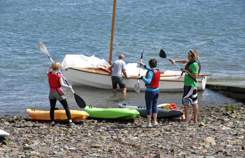 Try windsurfing, sailing or kayaking at the popular water sports centre in Dale just a short drive away