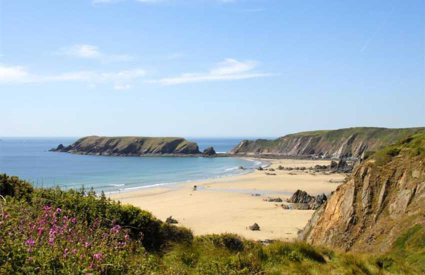 Marloes Sands for body boarding - a beautiful unspoilt beach at low tide with spectacular cliffs, brilliant for rock pooling and fossil hunting