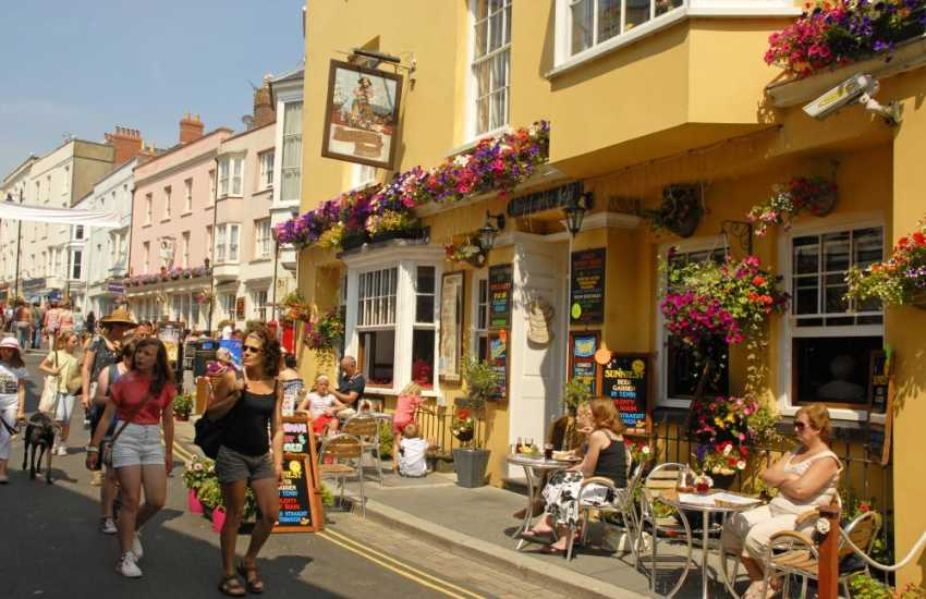 Soak up the atmosphere along the quaint cobbled streets of Tenby - a popular Victorian holiday resort with Blue   Flag beaches and a picturesque harbour where boats leave for Caldey Island