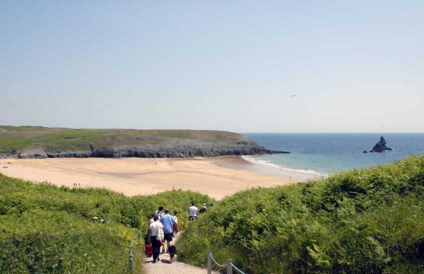 Broad Haven South (N.T) - a superb sheltered beach with it's famous 'Church Rock' in the bay - popular with families. Discover small caves among the cliffs during low tides