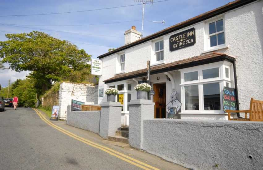 The Castle Inn in Manorbier is a cosy village pub serving good bar snacks and traditional ales, 'Menu remains virtually unchanged for 90 years!'