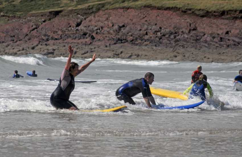 Fun in the waves on the beach at Manorbier