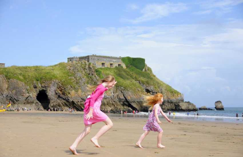 Having fun on Tenby South beach with St Catherine's island in the back drop