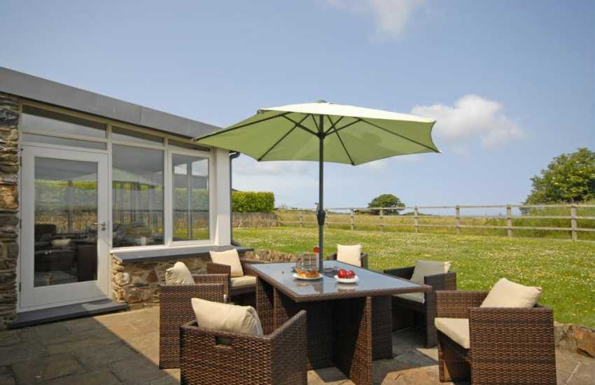 North Pembrokeshire holiday cottage - rear patio with lawns and coastal views
