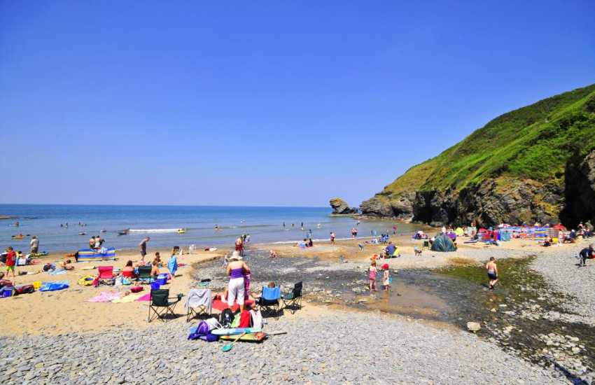 Llangrannog's golden sandy beach is popular with families - great for rock pooling and exploring the caves!