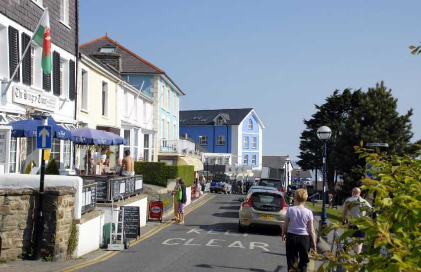 New Quay is a fascinating harbour village with golden sandy beaches and a sheltered harbour lined with lobster pots