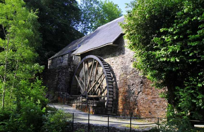 The nearby Dyfi charcoal-burning furnace dates from the mid 18th century. It is one of Britains best preserved furnaces. Its water wheel has been restored to working order