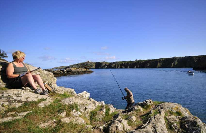 Fishermen and artists enjoy the peace and tranquility at Porth Eilian.