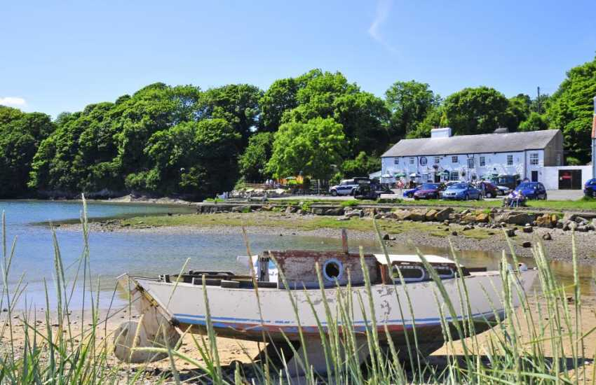 Red wharf Bay & the Ship Inn, the long sandy beach at low tide stretches for miles