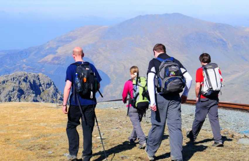 Take a day trip up to the summit of Snowdon, either on foot or by train. Snowdon is the highest peak in Wales, at 1085 meters above sea level