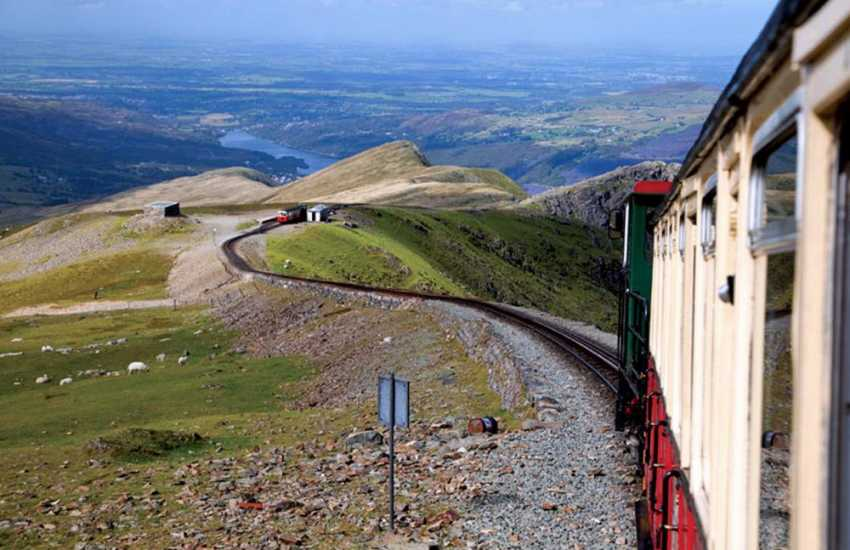Fantastic views from the Snowdon Mountain Railway - looking back down to Clogwyn Station (halfway stop at 700 mtrs) and breathtaking views from the summit (1,085 mtrs) - a clear day is a must for this journey!