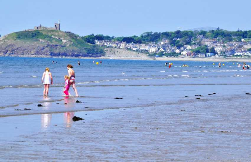 The drive-on beach at Blackrock sands with Criccieth castle in the background