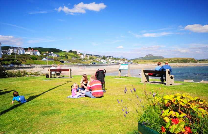 Families enjoying a picnic close to the sea-front at Criccieth