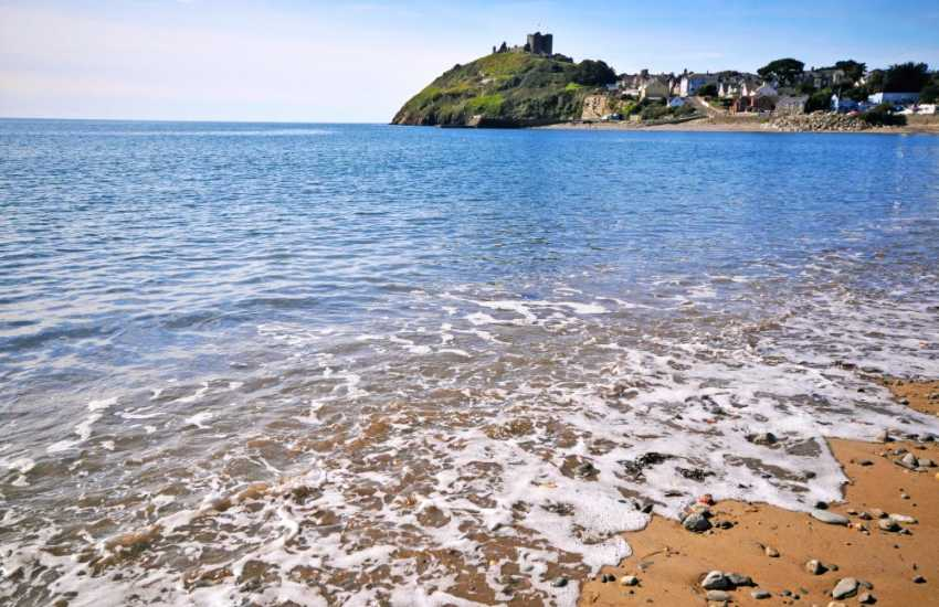 Criccieth beach with the Castle in the distance