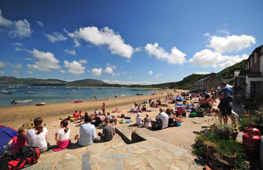 Grab a pint or a pub lunch from the Ty Coch Inn, right on the beach at Porthdinllaen