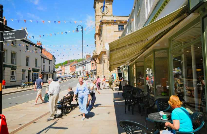 Welshpool High Street with its good variety of individual shops, cafes and market hall