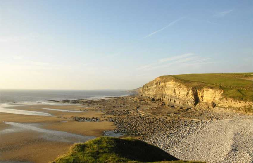 Dunraven Bay (Blue Flag) - a stunning sand and pebble beach just 5 minutes walk from the cottage - popular with families, water-sports enthusiasts and great for fossil hunting