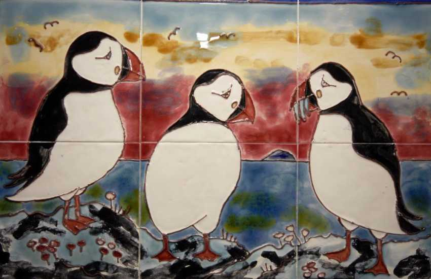 'Puffins', beautifully handmade wall tiles crafted by the owner of Troed y Garn