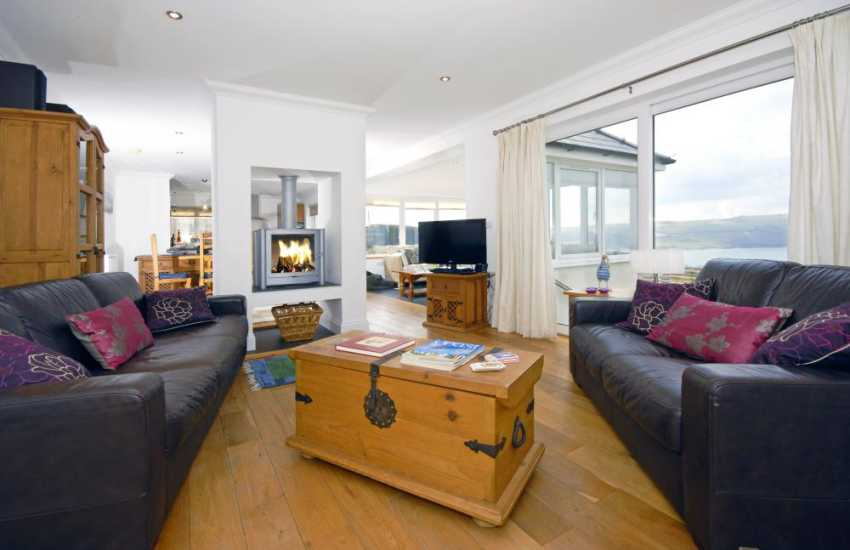 Cardigan Bay coastal home for holidays - lounge with central wood burning stove and stunning sea views