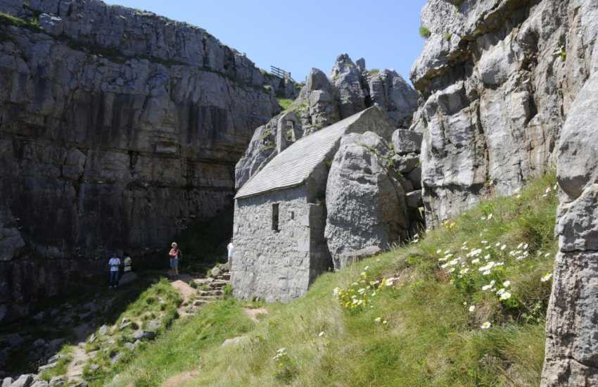 St Govan's Chapel - access is down steep steps carved into the side of the cliff. Count the number of steps down, tradition has it  that it will be a different count on the return climb!
