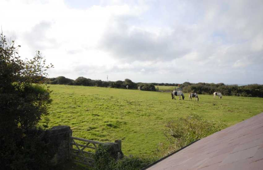 Views from the bedroom over surrounding countryside to the coast beyond