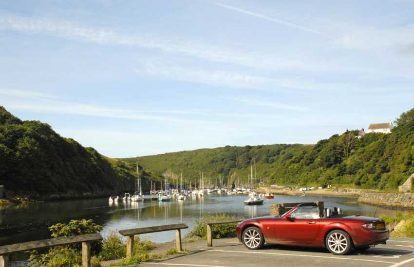 Solva is a picturesque harbour village with pubs, pottery, antique shop and a working woollen mill in which to browse