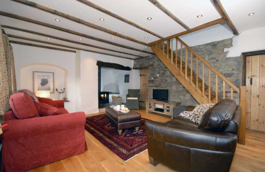 Abermawr self catering cottage - sitting room with inglenook fireplace and log burning stove