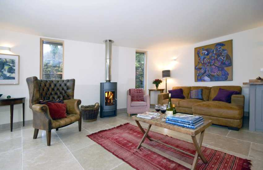 Luxury Pembrokeshire holiday cottage - living area with log burning stove