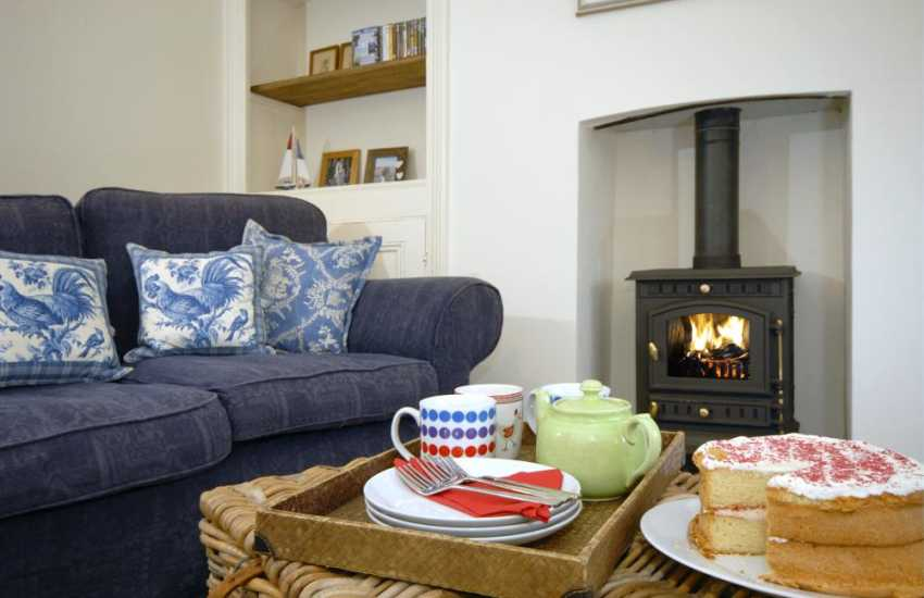 Cosy Pembrokeshire holiday home - sitting room with log burning stove