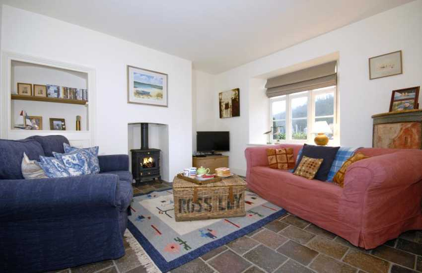Newport Pembrokeshire holiday home - cosy sitting room with wood burning stove and harbour views