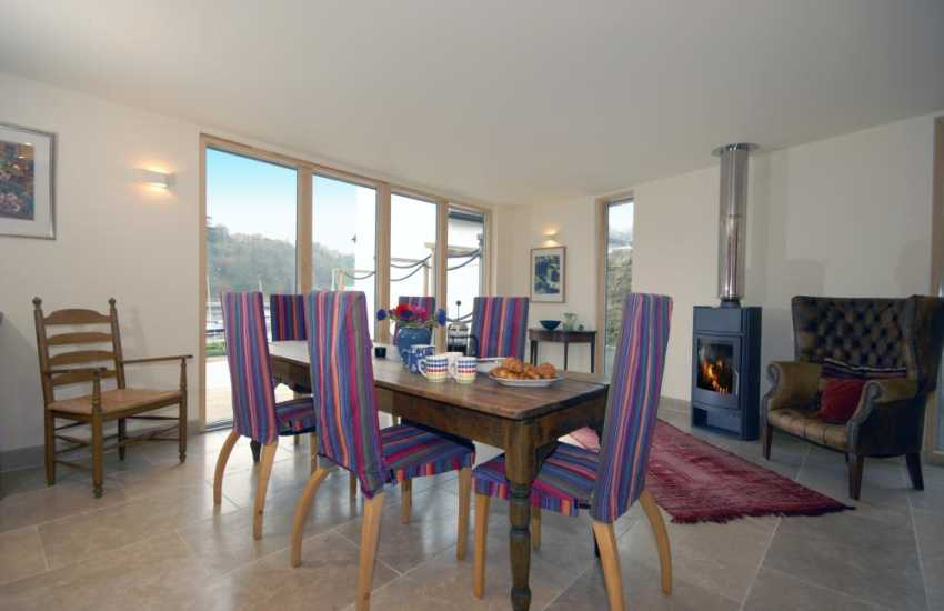 North Pembrokeshire holiday house - open plan dining area with wood burning stove