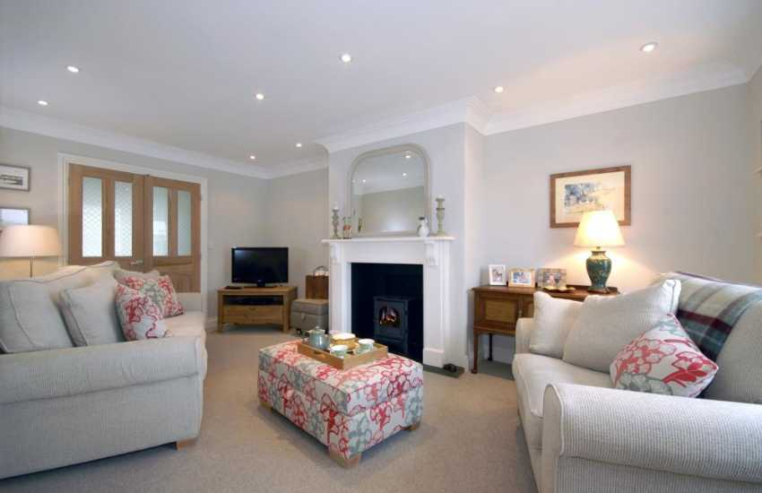 Modern Welsh home on the Haven Waterway - cosy lounge, oil burning stove and pets welcome