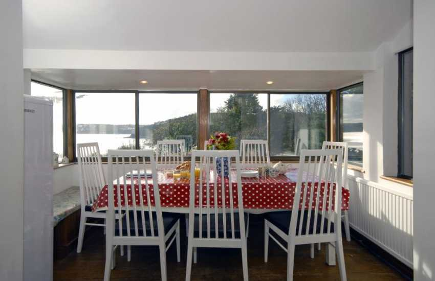 Self catering Wiseman's Bridge seaside holiday home - dining area with sea views