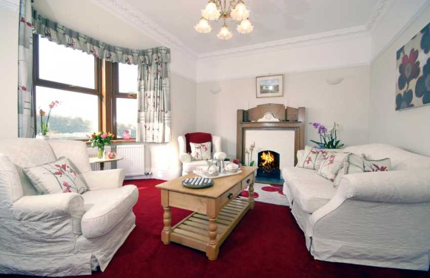North Pembrokeshire coast holiday home - sitting room with open fire