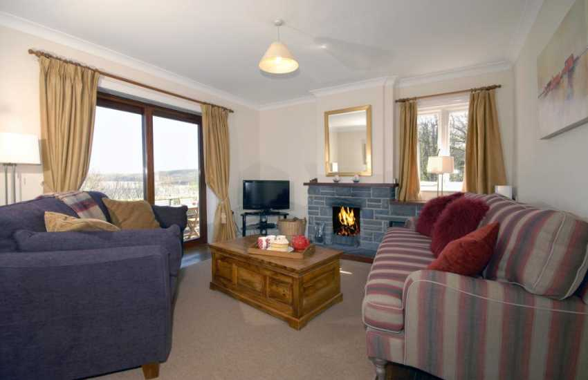 New Quay holiday cottage - sitting room with open fire and sea views