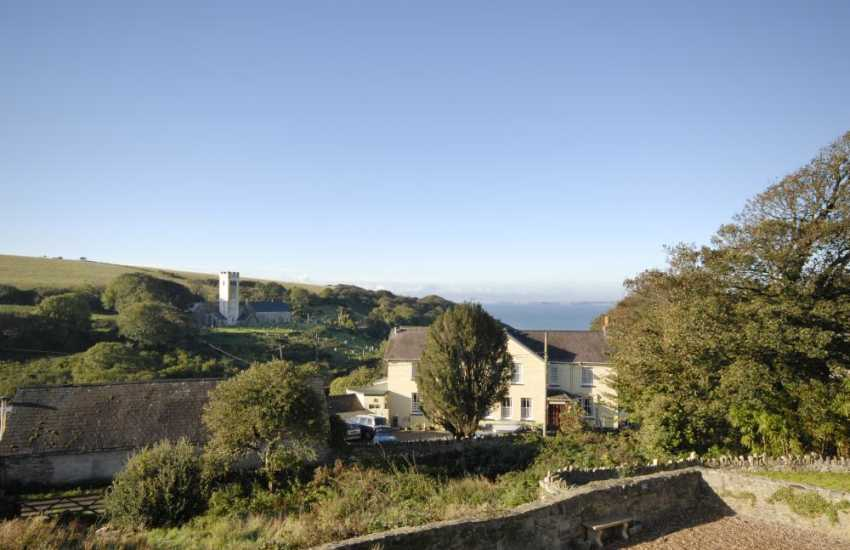 Enjoy lovely sea views across the valley from the cottage